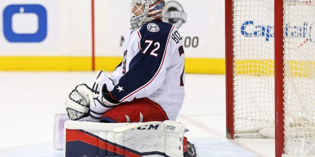 Jan 5, 2017; Washington, DC, USA; Columbus Blue Jackets goalie Sergei Bobrovsky (72) kneels on the ice after giving up a goal to Washington Capitals left wing Andre Burakovsky (not pictured) in the second period at Verizon Center. Mandatory Credit: Geoff Burke-USA TODAY Sports