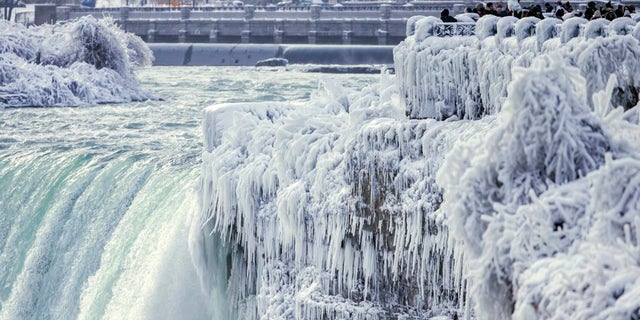 Niagara Falls was frozen solid by the Arctic temperatures blanketing much of the U.S.