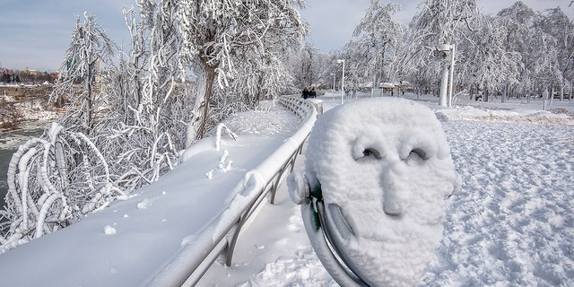 Jan. 2, 2018: A coin operated binocular is covered with snow on Goat Island at Niagara Falls State Park in Niagara Falls, N.Y.