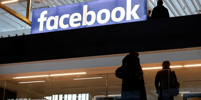 Facebook logo is seen  at a start-up companies gathering at Paris' Station F in Paris, France, January 17, 2017. REUTERS/Philippe Wojazer - RC1F2BC5E4F0