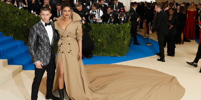Nick Jonas and his now-wife Priyanka Chopra at the 2017 Met Gala where the couple met. Chopra donned a custom Ralph Lauren gown as she did on her wedding day.