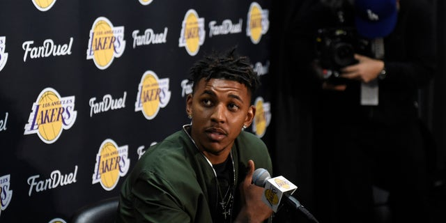 Mar 30, 2016; Los Angeles, CA, USA; Los Angeles Lakers forward Nick Young (0) at press conference related to guard D'Angelo Russell (1) at Staples Center. Mandatory Credit: Richard Mackson-USA TODAY Sports  - RTSCX9U