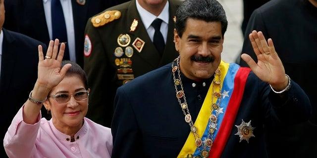 Venezuelan President Nicolas Maduro with his wife, Cilia Flores.