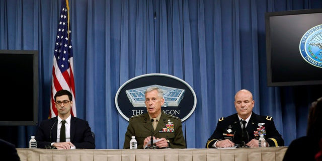 Marine Gen. Thomas D. Waldhauser, commander, U.S. Africa Command, center, with Assistant Secretary of Defense for International Security Affairs Robert S. Karem, left, and Army Maj. Gen. Roger L. Cloutier, right, chief of staff, U.S. Africa Command, and lead investigating officer, brief members of the media at the Pentagon, Thursday, May 10, 2018.
