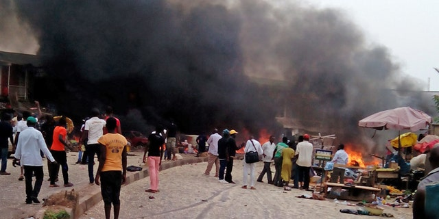 May 20, 2014: Smoke rises after a bomb blast at a bus terminal in Jos, Nigeria.