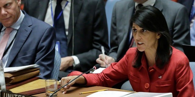 United Kingdom U.N. Ambassador Matthew Rycroft, left, listens as United States U.N. Ambassador Nikki Haley, right, respond to Russia's statements, during United Nations Security Council meeting on North Korea's latest launch of an intercontinental ballistic missile, Wednesday July 5, 2017 at U.N. headquarters. (AP Photo/Bebeto Matthews)