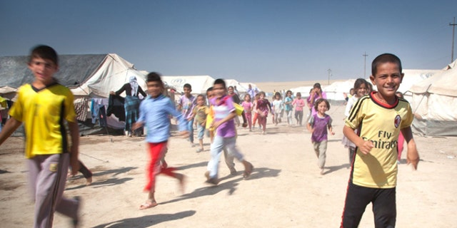 Many of the Yazidi and Assyrian familes have been at refugee camps near the Iraq-Turkish border.
