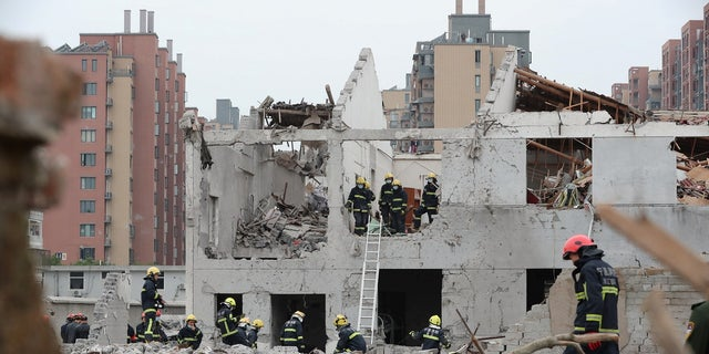 Rescue workers examine the site of a blast in Ningbo, Zhejiang province, China, Nov. 26, 2017.