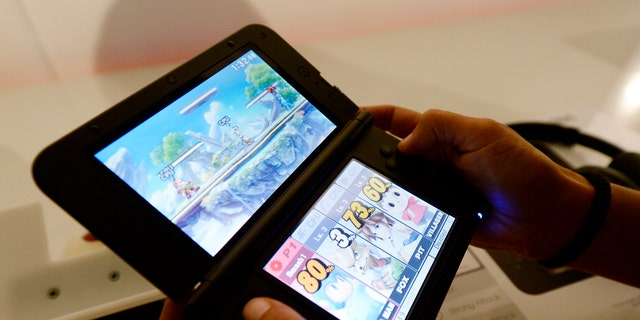 File photo: An attendee plays the Super Smash Bros game for Nintendo 3DS at the 2014 Electronic Entertainment Expo, known as E3, in Los Angeles, California June 11, 2014. (REUTERS/Kevork Djansezian)