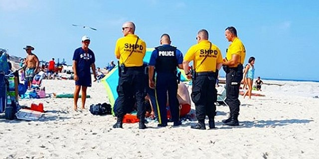 A beachgoer said there was a strong gust of wind at the time of the incident.