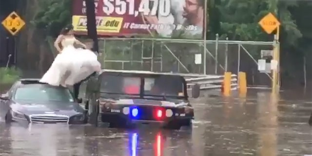 A bride and groom became trapped in flooding on Saturday, and had to be rescued by police in New Jersey.
