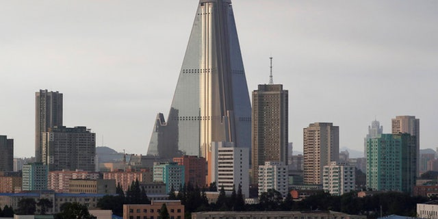 The 105-story Ryugyong hotel towers over residential buildings in Pyongyang, North Korea.