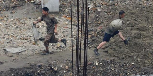 Labourers work at a construction site in Pyongyang.