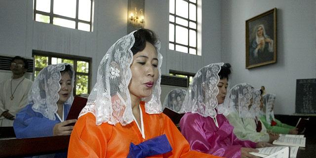 North Koreans read mass at a Catholic church in Pyongyang