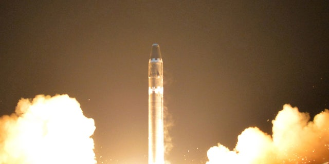 A view of the Hwasong-15's test. State media said that the missile was launched from a newly developed vehicle, and that the warhead could withstand the pressure of re-entering the atmosphere.
