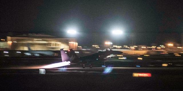 A U.S. Air Force F-15C Eagle takes off from the Kadena runway Sept. 23, 2017, at Kadena Air Base, Japan.