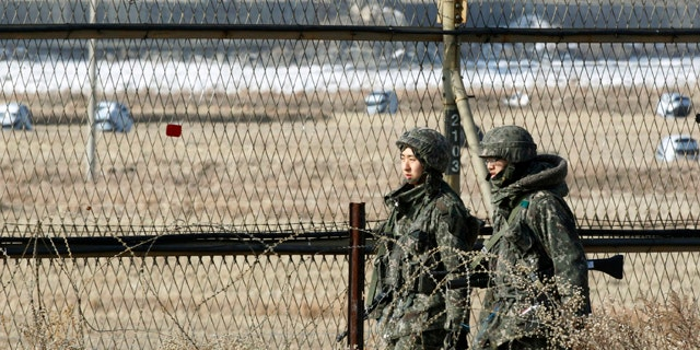 Jan. 27, 2013: South Korean army soldiers patrol along a barbed-wire fence in Paju, South Korea, near the demilitarized zone (DMZ) of Panmunjom.