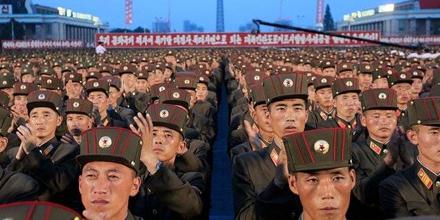 Soldiers gather in Kim Il Sung Square in Pyongyang, North Korea,Thursday, July 6, 2017, to celebrate the test launch of North Korea's first intercontinental ballistic missile two days earlier. The North's ICBM launch, its most successful missile test to date, has stoked security worries in Washington, Seoul and Tokyo as it showed the country could eventually perfect a reliable nuclear missile capable of reaching anywhere in the United States. Analysts say the missile tested Tuesday could reach Alaska if launched at a normal trajectory. (AP Photo/Jon Chol Jin)