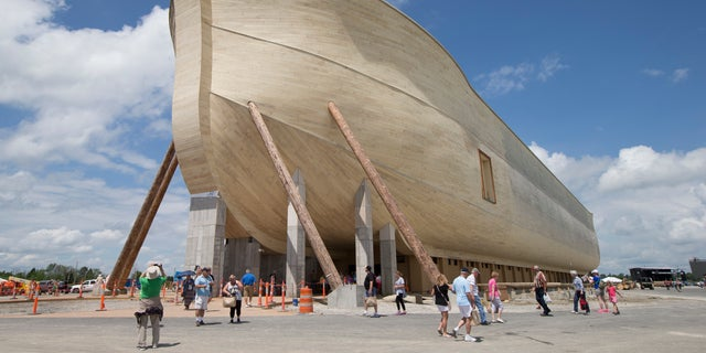 July 5, 2016: Visitors pass outside the front of a replica Noah's Ark at the Ark Encounter theme park during a media preview day in Williamstown, Ky.