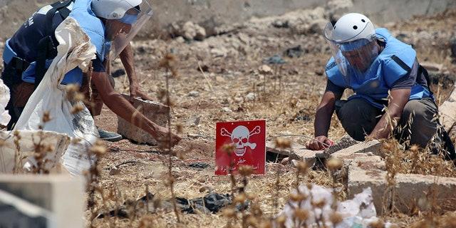 Civil defense members prepare to safely detonate cluster bombs in the rebel-held area in Deraa, Syria July 26, 2017. Picture taken July 26, 2017.  REUTERS/Alaa al-Faqir - RC1836418E70