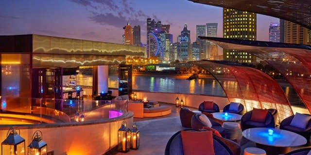 The expansive rooftop of Nobu Doha affords great city views in a luxurious setting.