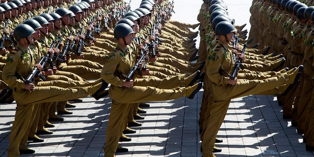 Soldiers march past during a parade for the 70th anniversary of North Korea's founding day in Pyongyang, North Korea, Sept. 9, 2018.