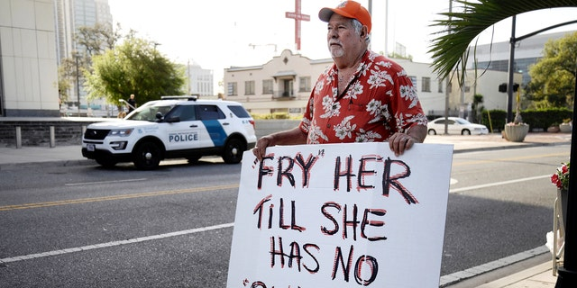 Bob Kunst protests against the widow of the Pulse nightclub shooter Noor Salman, who faces charges of aiding her husband in killing 49 people in 2016, outside the federal court house in Orlando, Florida,