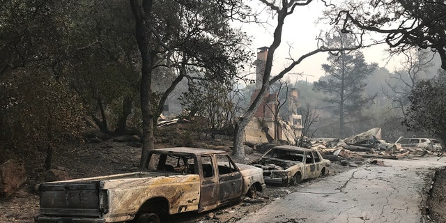 Charred remains of vehicles after wildfires in Northern California.