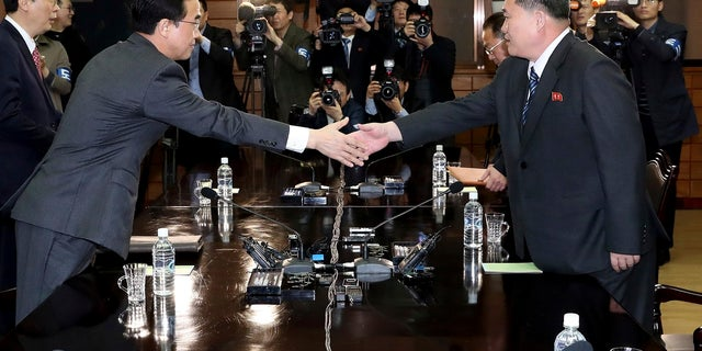 March 29: South Korean Unification Minister Cho Myoung-gyon, left, shakes hands with North Korean delegation head Ri Son Gwon before their meeting at the northern side of the Panmunjom, North Korea.