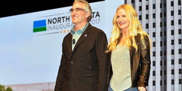 Last month, a GOA-backed bill was signed by North Dakota Governor Doug Burgum (left) to make his state the 14th in the country to allow residents carry without a permit.