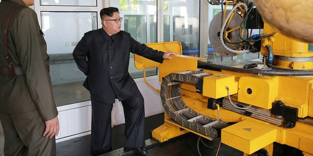 Kim Jong Un, center, visits the Chemical Material Institute of Academy of Defense Science at an undisclosed location in North Korea.