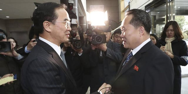 January 9, 2017: South Korean Unification Minister Cho Myoung-gyon, left, shakes hands with the head of North Korean delegation Ri Son Gwon before their meeting at the Panmunjom in the Demilitarized Zone in Paju, South Korea.