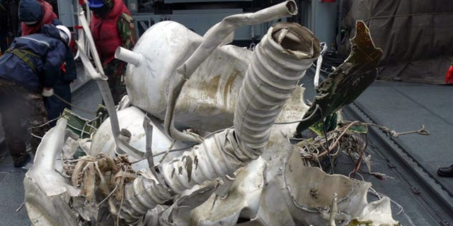 Dec. 23, 2012: In this undated photo released by South Korean Defense Ministry on, a part of debris from a rocket North Korea launched on Dec. 12, 2012 is seen on a South Korean navy vessel in the Yellow Sea, South Korea.