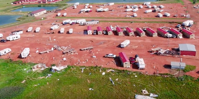 This aerial image from video, shot with a drone provided by HRI Aerial Imaging, shows damage at an RV park Tuesday, July 10, 2018, in Watford City, N.D..