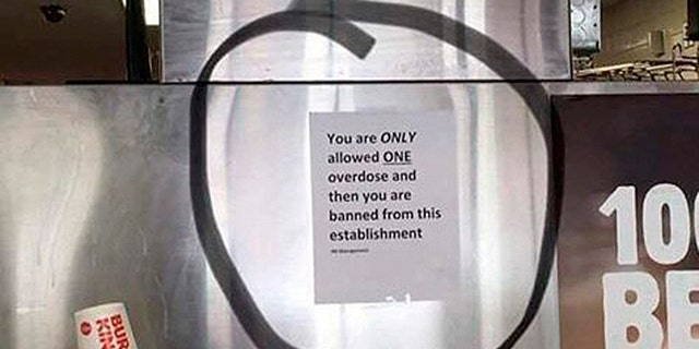 A Burger King in Worcester, Mass. has removed a sign about overdosing that was hanging behind the counter.