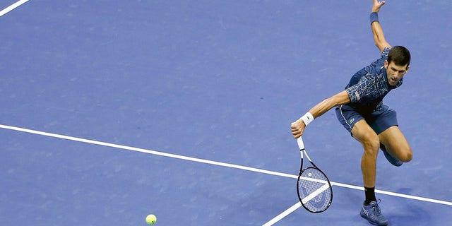 Novak Djokovic, of Serbia, returns a shot to Juan Martin del Potro, of Argentina, during the men's final of the U.S. Open tennis tournament, Sunday, Sept. 9, 2018, in New York. (AP Photo/Jason DeCrow)