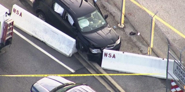 An SUV with bullets was stopped by barriers.