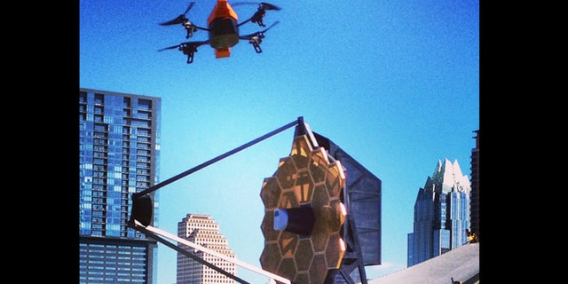 NSF drone flies over the James Webb Space Telescope replica in Austin.