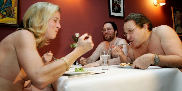 A Group Of Nudists Eat Together At Clothing Optional Dinner New
