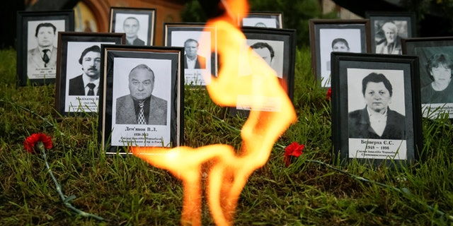"Portraits of ""liquidators"", emergency workers who fought the blaze at the Chernobyl nuclear reactor, are seen during a commemoration ceremony in Kiev, Ukraine, April 26, 2016.  REUTERS/Gleb Garanich - RTX2BPDA"