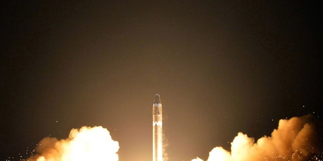 This image shows what the North Korean government calls the Hwasong-15 intercontinental ballistic missile at an undisclosed location in North Korea.