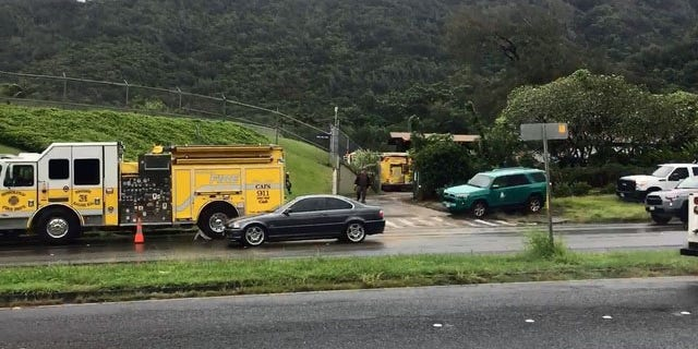 Emergency crews gather near the Nuuanu Reservoir in Oahu, Hawaii.