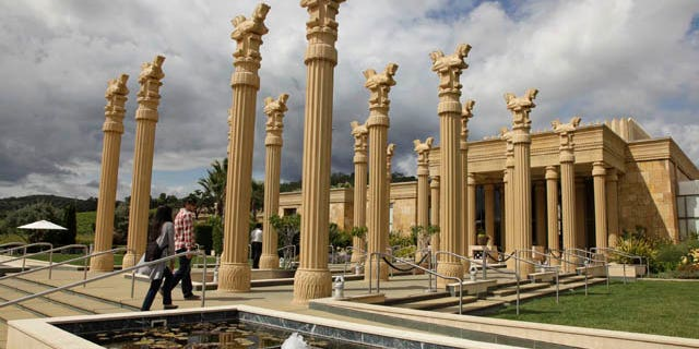 This Thursday, June 2, 2011 photo shows a couple as they make their way in the Darioush winery in Napa, Calif. The winery is notable for its striking architecture which incorporates references to Persepolis, the capital of ancient Persia. Blessed with lavish scenery and luscious wines, the Napa Valley is the kind of place you could spend days exploring. But its compact enough that even if you only have an afternoon you can still get a taste of wine country. (AP Photo/Eric Risberg)