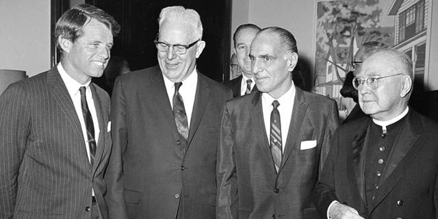 U.S. Sen. Robert K. Kennedy, from left, Supreme Court Chief Justice Earl Warren, Assembly Speaker Anthony J. Travia, and Francis Cardinal Spellman attend New York State's Ninth Constitutional Convention at the Capitol in Albany, N.Y.