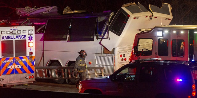 April 8, 2018: Police and firefighters respond to the scene of a charter bus accident on the eastbound Southern State Parkway in Lakeview, N.Y