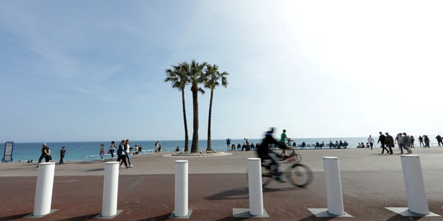 Concrete bollard barriers provide security on the Promenade des Anglais that were installed after the July 2016 truck attack, in Nice, France, April 12, 2017.