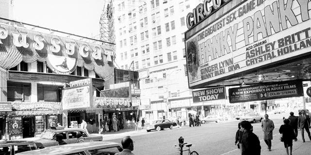 This Oct. 4, 1984 file photo shows porn shops in New York's Times Square.