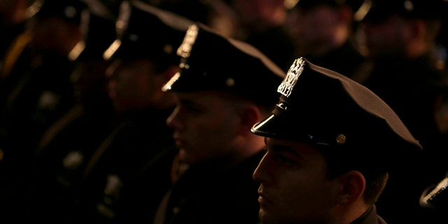 New graduates of the NYPD Police Academy participate in a ceremony.