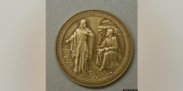 A commemorative medallion to mark the first year of Pope Francis' papacy has been recalled because it misspelled the word 'Jesus.'