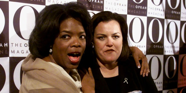 "Oprah Winfrey with Rosie O'Donnell, who holds a copy of ""O, the Oprah Magazine."""